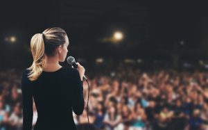 public_speaking_stage_woman